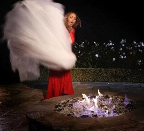 این زن مشهور لباس عروسی میلیاردیش را آتش زد